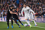 Cristiano Ronaldo of Real Madrid (in white) fights for the ball with Elseid Hysaj of SSC Napoli and teammate Jose Callejon (in black) with during the match Real Madrid vs Napoli, part of the 2016-17 UEFA Champions League Round of 16 at the Santiago Bernabeu Stadium on 15 February 2017 in Madrid, Spain. Photo by Diego Gonzalez Souto / Power Sport Images
