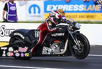 Jun 5, 2015; Englishtown, NJ, USA; NHRA pro stock motorcycle rider Angie Smith during qualifying for the Summernationals at Old Bridge Township Raceway Park. Mandatory Credit: Mark J. Rebilas-