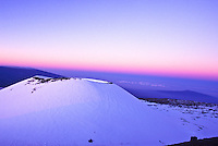 Mauna Kea with snow around the cindercone at sunset