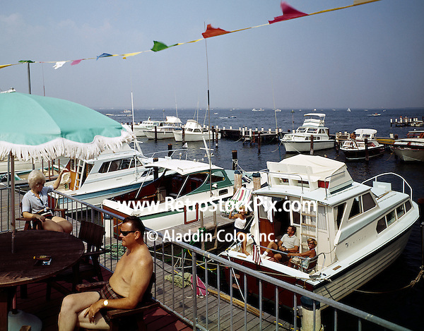 Marina Dock with old wooden boats and families.
