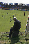 Faroe Islands 0 Scotland 2, 06/06/2007. European Championship Qualifier. A Faroese man watching the action from the hillside outside the ground as the Faroe Islands take on Scotland in a Euro 2008 group B qualifying match at the Svangaskard stadium in Toftir. The visitors won the match by 2 goals to nil to stay in contention for a place at the European football championships which were to be held in Switzerland and Austria in the Summer of 2008. It was the first time Scotland had won in the Faroes, the previous two matches ended in draws. Photo by Colin McPherson.