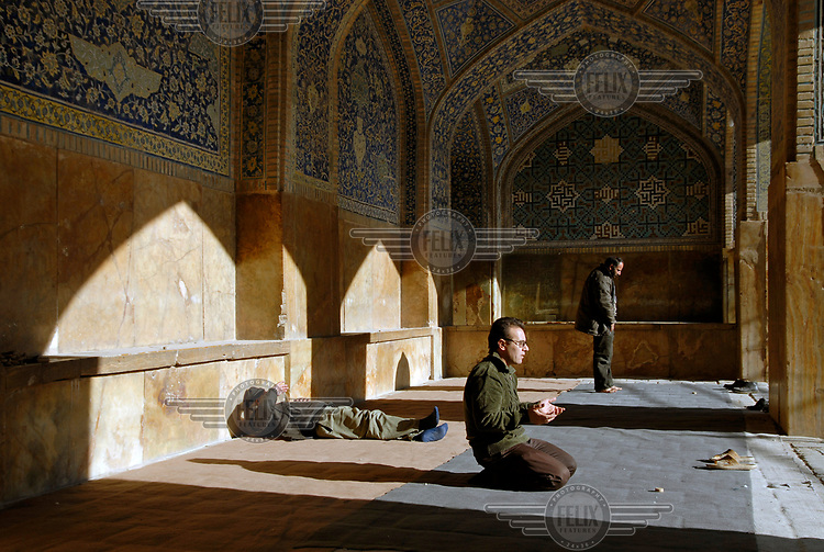 A man prays in the courtyard of the Imam Mosque on Naqsh-e Jahan square (Khomeini Square)