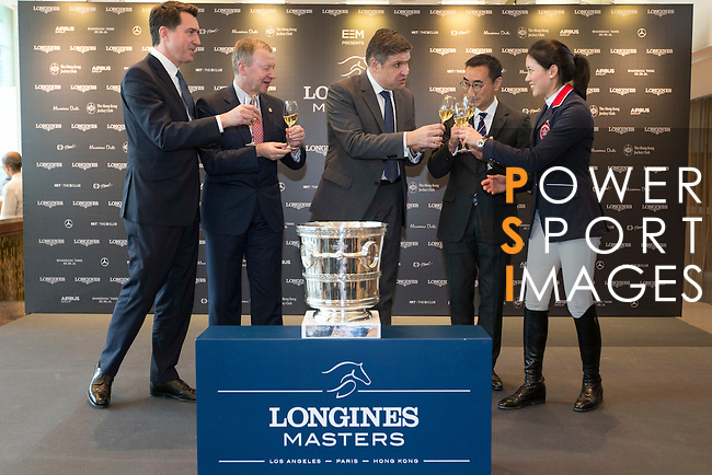 L-R: Fabien Grobon, Managing Director of EEM, Winfried Engelbrecht-Bresges, JP, CEO of The Hong Kong Jockey Club, Juan-Carlos Capelli, Vice-President and Head of International Marketing of Longines, Michael Lee, President of Hong Kong Equestrian Federation, Jacqueline Lai, Masters rider, raise a glass at Longines Hong Kong Masters official press conference at the Happy Valley Racetrack on February 02, 2016 in Hong Kong.  Photo by Victor Fraile / Power Sport Images