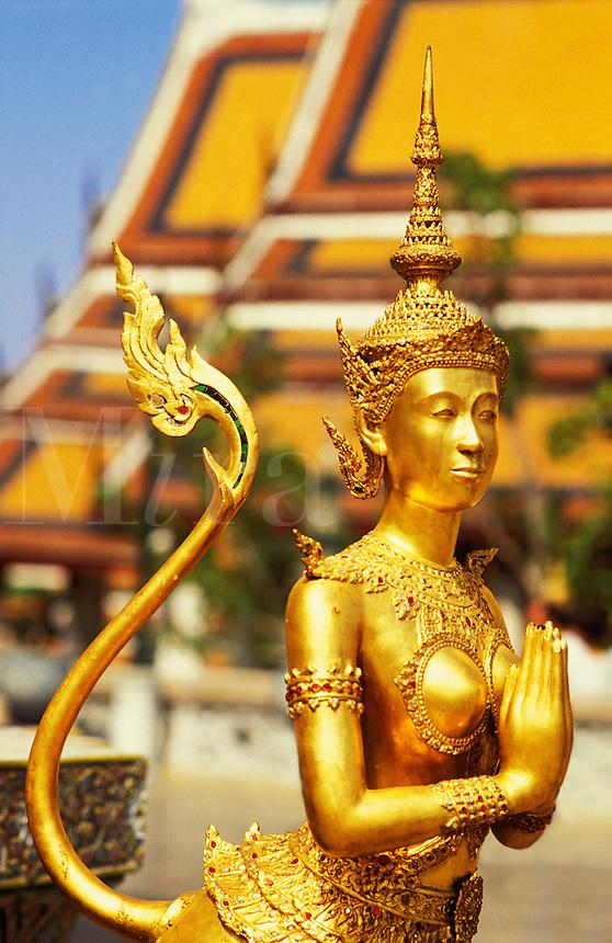 Thailand. Bangkok. Wat Phra Keo. Temple of the Emerald Buddha. Gold image of a mythical goddess.