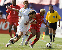 Panama's Julio Medina III looks to hold off USA's Frankie Hejduk. The United States defeated Panama 3-1 in a shoot out after a scoreless game to win the CONCACAF Gold Cup at Giant's Stadium, East Rutherford, NJ, on July 24, 2005.