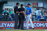 Home plate umpire Jake Bruner gets between Myrtle Beach Pelicans manager Steve Lerud (39) and umpire Mark Bass during the game against the Winston-Salem Dash at TicketReturn.com Field on May 16, 2019 in Myrtle Beach, South Carolina. The Dash defeated the Pelicans 6-0. (Brian Westerholt/Four Seam Images)