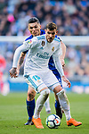 Theo Hernandez (R) of Real Madrid battles for the ball with Daniel Alejandro Torres Rojas, D Torres, of Deportivo Alaves during the La Liga 2017-18 match between Real Madrid and Deportivo Alaves at Santiago Bernabeu Stadium on February 24 2018 in Madrid, Spain. Photo by Diego Souto / Power Sport Images