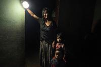 25 noviembre 2014. María Dolores Caal, de 50 años, y su marido Ramiro Sierra, de 50, viven en Chacalté (Cobán, Guatemala), una pequeña aldea que está muy cerca de la hidroeléctrica Renace pero no tiene luz ni en calles ni en casas. Esta matrimonio tiene que utilizar bombillas solares. Tienen dos hijos: Flor de María, de 5 años, y Essau, de dos. En Cobán (Guatemala) la hidroeléctrica española Renace se ha instalado con amenazas a la población y falsas promesas de desarrollo para la zona. La compañía también ha prohibido el acceso al río Cahabón para miles de personas y no ha respetado la estrecha relación de los indios mayas con el medio ambiente. Renace es una empresa guatemalteca, pero ha dado el contrato de la construcción de la hidroeléctrica a la empresa española Cobra (FCC). El proyecto ha dividido a la población entre partidarios y detractores. ©Calamar2/ Pedro ARMESTRE<br /> <br /> <br /> Maria Dolores Caal, 50 years old and her husband Ramiro Sierra, 52 years old, live in Chacalté (Cobán, Guatemala), a small village that it is very close to the hydroelectric Renace but it has no electricity. They have to use solar bulbs. They have two children: Flor de María, 5 years old, and Esau, two years old. The arrival of foreign companies to Latin America has provoked abuses of the rights of indigenous people and repression of their defense of the environment. In Coban, in Guatemala, the hydroelectric Renace has been installed with threats to the population and false promises of development for the area. The company has also forbidden the access to the river for thousands of people and has no respected the close relationship of the Maya Indians with environment. Renace is a Guatemaltecan company but has given the contract of the  construction of the hydroelectric to the spanish company Cobra. The project has divided the population and has caused riots. The project has very close families that live in extrem poverty. They are people that leave close to the hyd