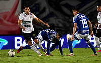 BOGOTA - COLOMBIA, 27-11-2020: Matias de los Santos, Juan Garcia de Millonarios F. C. y Roberto Ovelar de Once Caldas disputan el balon, durante partido entre Millonarios F. C. y Once Caldas de la fecha 1 por la Liguilla BetPlay DIMAYOR 2020 jugado en el estadio Nemesio Camacho El Campin de la ciudad de Bogota. / Matias de los Santos, Juan Garcia of Millonarios F. C. and Roberto Ovelar of Once Caldas figth for the ball, during a match between Millonarios F. C. and Once Caldas of the 1st date for the BetPlay DIMAYOR 2020 Liguilla played at the Nemesio Camacho El Campin Stadium in Bogota city. / Photo: VizzorImage / Luis Ramirez / Staff.
