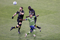 COLUMBUS, OH - DECEMBER 12: Josh Williams #3 of the Columbus Crew heads the ball away from Jonathan Mensah #4 of the Columbus Crew and Raul Ruidiaz #9 of the Seattle Sounders FC during a game between Seattle Sounders FC and Columbus Crew at MAPFRE Stadium on December 12, 2020 in Columbus, Ohio.