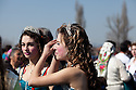 """Two sisters, Minka, 19, left, and Donka Koleva, 16, at the annual meeting of the Kalaidzhii.  At the annual meeting in Mogila, young women dress up to attract mates, who are required by tradition to pay a large sum of money to the bride's family, called """"baba hak"""". PHOTO BY JODI HILTON"""
