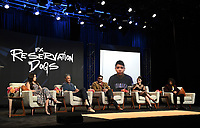 """BEVERLY HILLS, CA - AUGUST 4: (L-R) Cast member Paulina Alexis, Co-Creator/Executive Producer/Writer Taika Waititi, Co-Creator/Writer/Director Sterlin Harjo, and cast members Devery Jacobs, D'Pharaoh Woon-A-Tai and Lane Factor (via video) attend the FX Networks 2021 Summer Television Critics Association session for """"Reservation Dogs"""" at the Beverly Hilton on August 4, 2021 in Beverly Hills, California. (Photo by Frank Micelotta/FX/PictureGroup)"""
