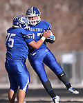 Carson's Maurilio Olivares celebrates with Seamus Burns after he scores against Reed during the NIAA D-1 Northern Regional title game at Bishop Manogue High School in Reno, Nev., on Saturday, Nov. 29, 2014. Reed won 28-25.<br /> Photo by Cathleen Allison