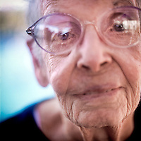 A portrait of 90 year old Joyce Riley who is a member of the Aquadettes at Laguna Woods, California. The Aquadettes are a group of women ageing from their early 60s upwards who meet to practice synchronised swimming. Every year, they practice together, they make costumes together, they swim together, and at the end, they perform together.