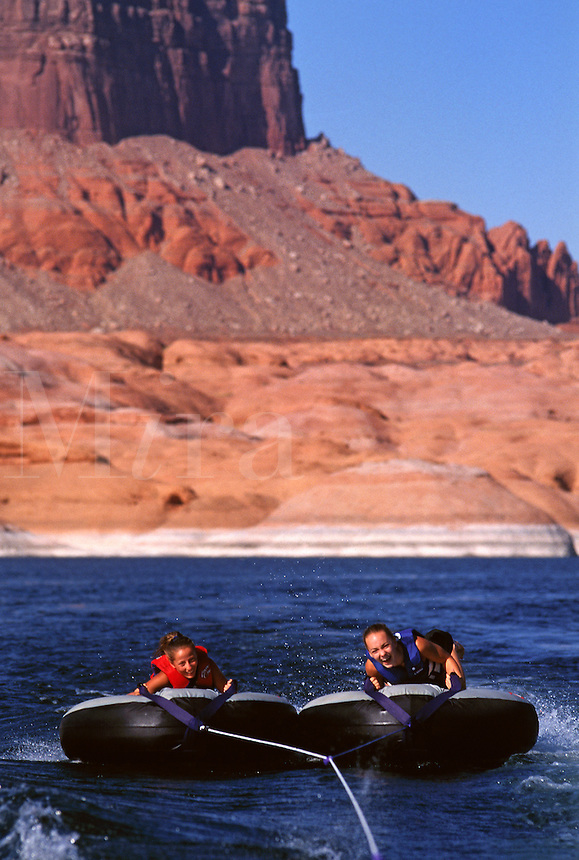 A fast ride on INNERTUBES makes for great fun at LAKE POWELL NATIONAL RECREATION AREA, UTAH