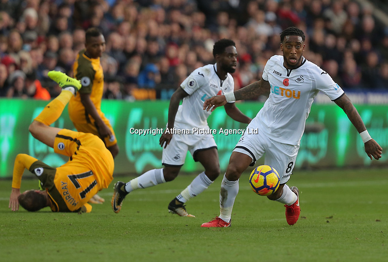Leroy Fer of Swansea City (R) in action during the Premier League match between Swansea City and Brighton and Hove Albion at The Liberty Stadium, Swansea, Wales, UK. Saturday 04 November 2017