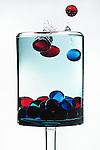 Glass marbles splashing in water
