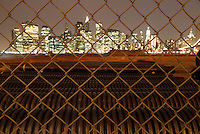 AVAILABLE FROM PLAINPICTURE.COM FOR COMMERCIAL AND EDITORIAL LICENSING.  Please go to www.plainpicture.com and search for image # p5690145.<br /> <br /> Lower Manhattan Financial District Skyline Viewed thru Chain Link Fence, Construction Site in Brooklyn visible in the Foreground, New York City, New York State, USA