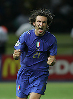 Italian midfielder (21) Andrea Pirlo celebrates converting his penalty kick.  Italy defeated France on penalty kicks after leaving the score tied, 1-1, in regulation time in the FIFA World Cup final match at Olympic Stadium in Berlin, Germany, July 9, 2006.