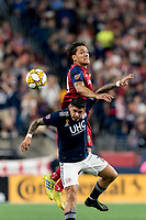 FOXBOROUGH, MA - SEPTEMBER 21: Gustavo Bao #7 of New England Revolution and Marcelo Silva #30 of Real Salt Lake battle for head ball during a game between Real Salt Lake and New England Revolution at Gillette Stadium on September 21, 2019 in Foxborough, Massachusetts.