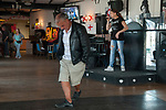 Leysdown on Sea, Isle of Sheppey, Kent, UK 2014. Young woman singing in empty working class pub a man dances by himself.