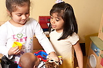 Education Preschool 4 year olds two girls talking and playing with doll