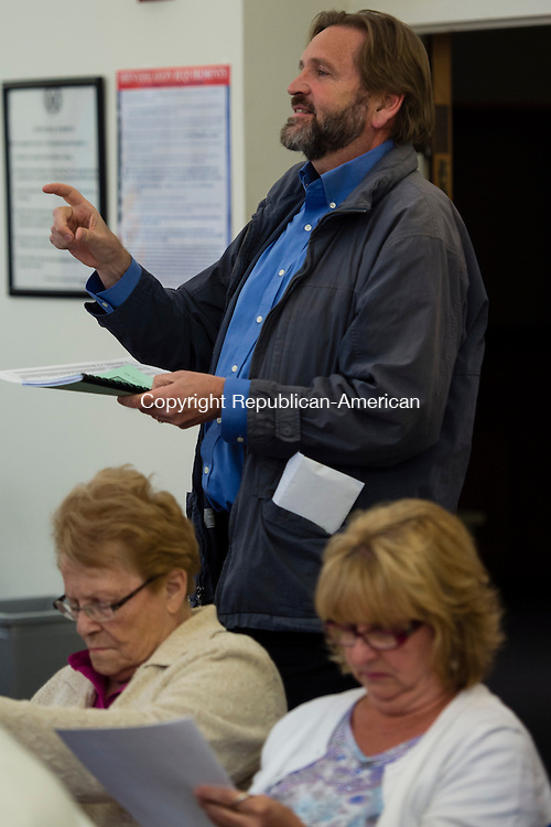 HARWINTON, CT- 17 May 2016-051716EC21-  Harwinton resident Paul Roche poses a question to the Board of Selectmen during the budget meeting Tuesday night at Harwinton Town Hall. About 75 residents showed up. Erin Covey Republican-American