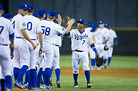 Oliver Nunez (7) of the Burlington Royals high fives his teammates after their win over the Danville Braves at Burlington Athletic Stadium on August 15, 2017 in Burlington, North Carolina.  The Royals defeated the Braves 6-2.  (Brian Westerholt/Four Seam Images)