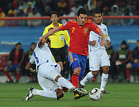 David Vila dribbles through a Honduran tackle towards goal. Spain defeated Honduras, 2-0, in their second match of play in Group H  in a match played Monday, June 21st, at Ellis Park in Johannesburg, South Africa at the 2010 FIFA World Cup..