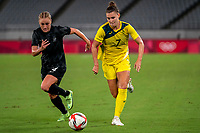 21st July 2021. Tokyo, Japan;  Steph Catley from Australia and CJ Bott from New Zealand during the entee Australia and New Zealand soccer game at the 2021 Tokyo Olympic Games held in Tokyo, Japan