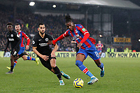 Wilfried Zaha of Crystal Palace takes on Martín Montoya of Brighton & Hove Albion during the Premier League match between Crystal Palace and Brighton and Hove Albion at Selhurst Park, London, England on 16 December 2019. Photo by Carlton Myrie / PRiME Media Images.