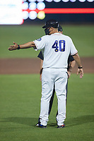 Kannapolis Cannon Ballers manager Guillermo Quiroz (40) argues a call with umpire Lane Cullipher during the game against the Down East Wood Ducks at Atrium Health Ballpark on May 5, 2021 in Kannapolis, North Carolina. (Brian Westerholt/Four Seam Images)