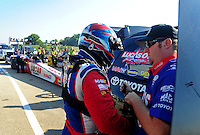 Jul, 8, 2011; Joliet, IL, USA: NHRA top fuel dragster driver Shawn Langdon and crew member during qualifying for the Route 66 Nationals at Route 66 Raceway. Mandatory Credit: Mark J. Rebilas-