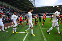 Pictured: Ki Sung-Yueng of Swansea (C). Tuesday 28 August 2012<br /> Re: Capital One Cup game, Swansea City FC v Barnsley at the Liberty Stadium, south Wales.