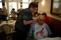 The only thing Olga likes more than boiling lobster is singing old Franco tunes with her fascist buddies in her restaurant.  She has the best lobster in all of Gallicia...Restaurante Marisqueria OLGA.Olga Gonzalez Rodriguez.Malteses, 24.La Guardia.Pontevedra.986 61 15 16..She is putting bib on Antonio Verisimo Martinez.986 26 42 58 his daughters phone her name is Ester Verisimo..