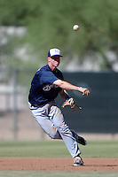Milwaukee Brewers third baseman Tucker Neuhaus (2) throws to first during an Instructional League game against the Los Angeles Angels on October 11, 2013 at Tempe Diablo Stadium Complex in Tempe, Arizona.  (Mike Janes/Four Seam Images)