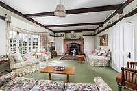 BNPS.co.uk (01202) 558833. <br /> Pic: SandersonYoung/BNPS<br /> <br /> Living room.<br /> <br /> A quirky 'show home' for a brickwork owner where Lewis Carroll is believed to have stayed while writing some of his Alice in Wonderland books is on the market for just under £1m.<br /> <br /> Red Cottage is a striking Grade II listed property in Whitburn, Tyne and Wear, where Charles Dodgson, otherwise known as Lewis Carroll, regularly visited family.<br /> <br /> The unusual 179-year-old home was built to show off as many design features as possible, and has a walled garden and even an air raid shelter.