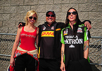Apr. 1, 2012; Las Vegas, NV, USA: NHRA funny car drivers Courtney Force (left), Jeff Arend (center) and Alexis DeJoria during the Summitracing.com Nationals at The Strip in Las Vegas. Mandatory Credit: Mark J. Rebilas-