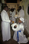 """The Celestial Church of Christ. A baby naming ceremony. The child is being held by a """"spirit medium"""", who will see into her future speaking in tongues. 1990s London UK This west African church was founded by S B J Oshoffa Mainly attended by Yoruba people from western Nigeria the church  flourishes with offshoots in London Paris and New York This  photograph is taken from the book The Storm is Passing Over"""""""