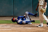 Rancho Cucamonga Quakes center fielder Jeren Kendall (24) grimaces in pain as he holds his shoulder after sliding into home plate during a California League game against the Visalia Rawhide on April 8, 2019 in Visalia, California. Rancho Cucamonga defeated Visalia 4-1. (Zachary Lucy/Four Seam Images)
