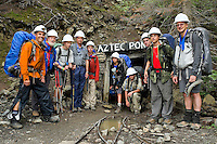 Photo story of Philmont Scout Ranch in Cimarron, New Mexico, taken during a Boy Scout Troop backpack trip in the summer of 2013. Photo is part of a comprehensive picture package which shows in-depth photography of a BSA Ventures crew on a trek. In this photo a BSA Ventures crew members poses for a photo outside the entrance to the Aztec gold mine near Ponil in the backcountry of the  Philmont Scout Ranch.   <br /> <br /> The  Photo by travel photograph: PatrickschneiderPhoto.com
