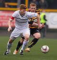 Raith Rovers' Jason Thomson holds off Alloas Liam Caddis.