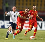 Scott Brown gets stuck into a battle with Stepjanovic and Pandev