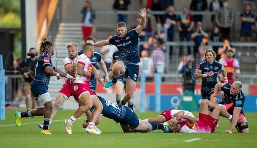 4th June 2021; AJ Bell Stadium, Salford, Lancashire, England; English Premiership Rugby, Sale Sharks versus Harlequins; Rob du Preezi of Sale Sharks has to jump to avoid Rohan Janse van Rensburg of Sale