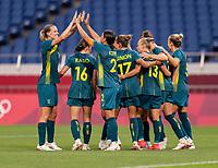 TOKYO, JAPAN - JULY 24: Emily van Egmond #10 celebrates with Sam Kerr #2 of Australia during a game between Australia and Sweden at Saitama Stadium on July 24, 2021 in Tokyo, Japan.