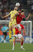 Ukrainian forward (7) Andriy Shevchenko goes up for a header against Swiss midfielder (6) Johann Vogel.  Ukraine defeated Switzerland on penalty kicks in their FIFA World Cup round of 16 match at FIFA World Cup Stadium in Cologne, Germany, June 26, 2006.