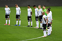 Players of Swansea City take part in a minutes silence during the Sky Bet Championship match between Swansea City and Cardiff City at the Liberty Stadium in Swansea, Wales, UK. Saturday 20 March 2021