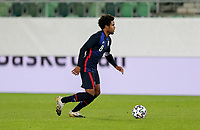 ST. GALLEN, SWITZERLAND - MAY 30: Weston McKennie #8 of the United States looks for an open man downfield during a game between Switzerland and USMNT at Kybunpark on May 30, 2021 in St. Gallen, Switzerland.