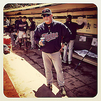 OAKLAND, CA - AUGUST 22: Instagram of manager Ron Gardenhire of the Minnesota Twins getting ready in the dugout before the game against the Oakland Athletics at O.co Coliseum on Wednesday, August 22, 2012 in Oakland, California. Photo by Brad Mangin