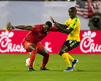 NASHVILLE, TN - JULY 3: Jozy Altidore #17 tries to hold of Elvis Powell #5 during a game between Jamaica and USMNT at Nissan Stadium on July 3, 2019 in Nashville, Tennessee.